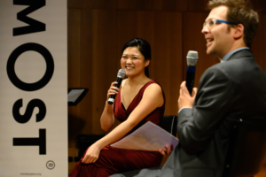 Violinist Emily Sun being interviewed by Michael Gonski.